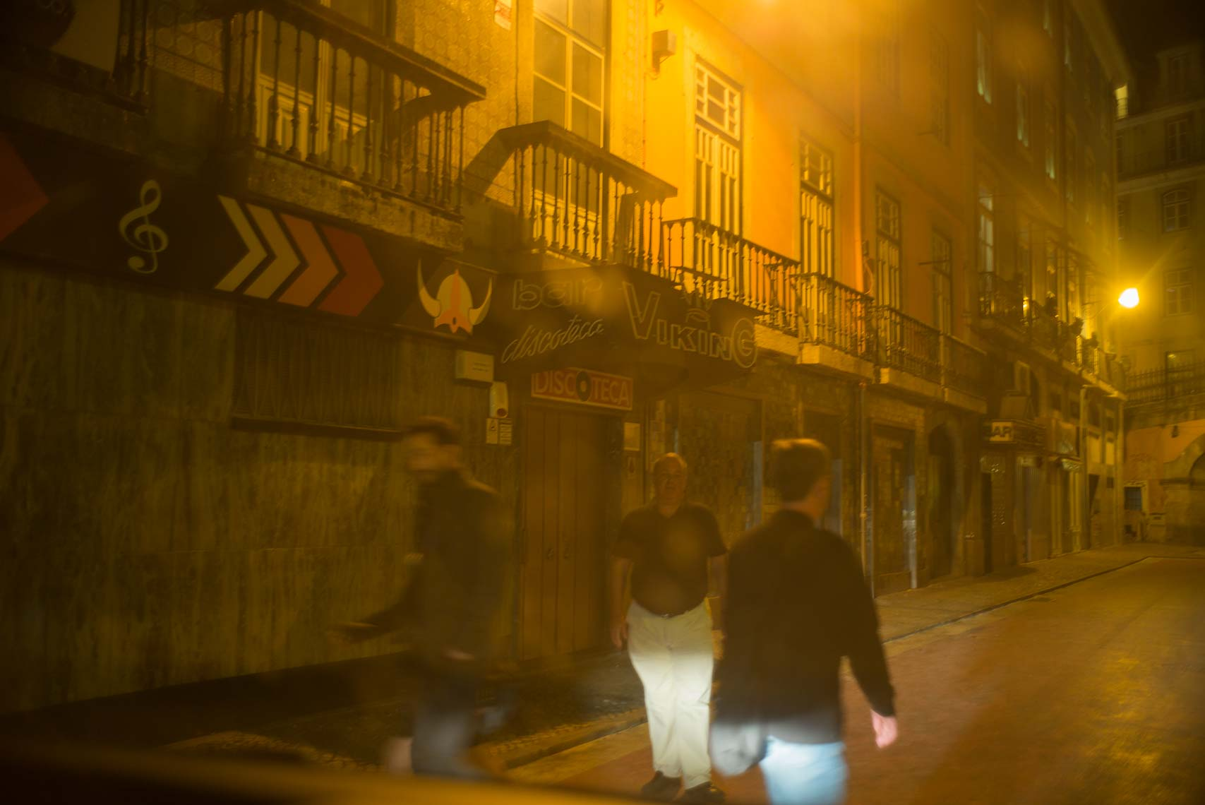 3-men-on-Lisbon-street-in-yellow-light