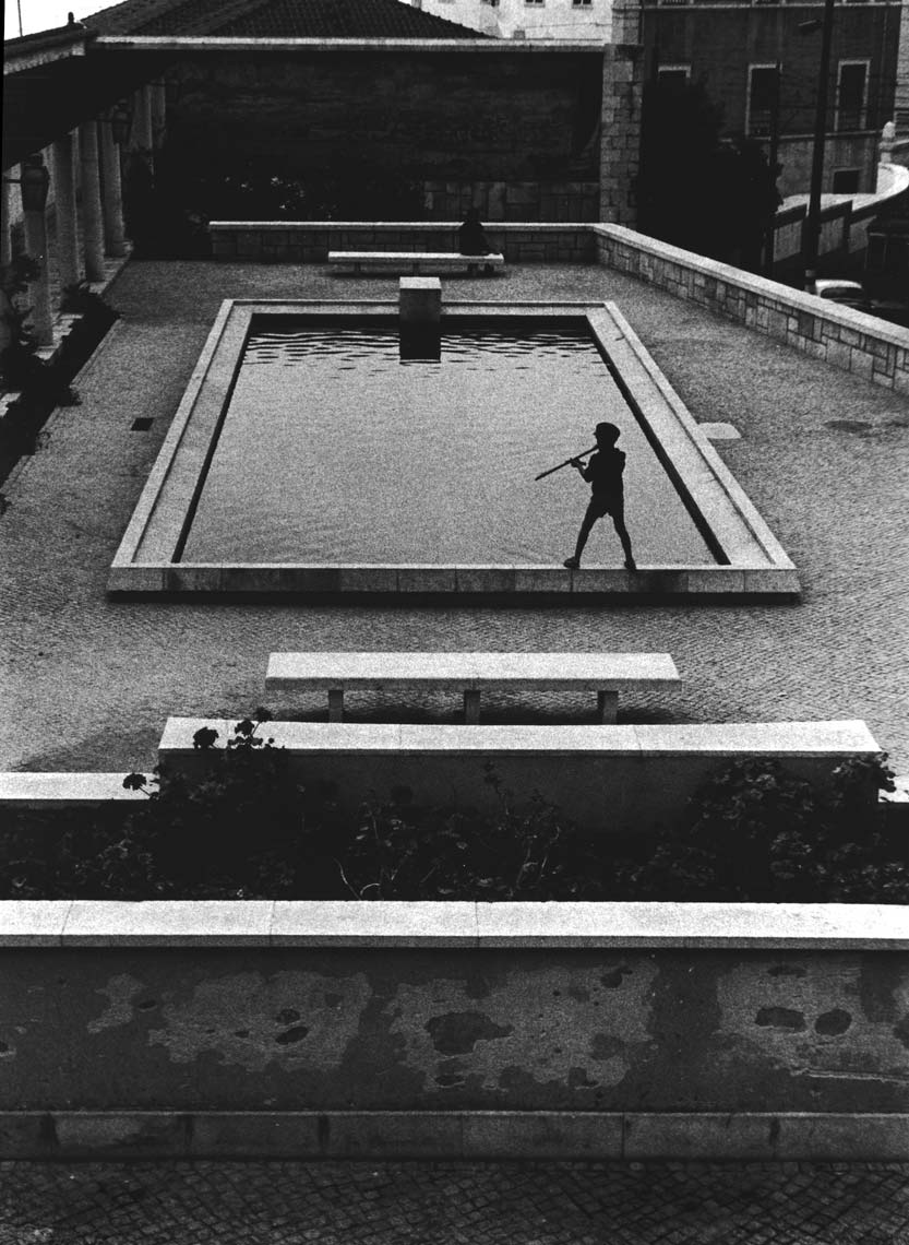 BOY PLAYING ON ROOFTOP