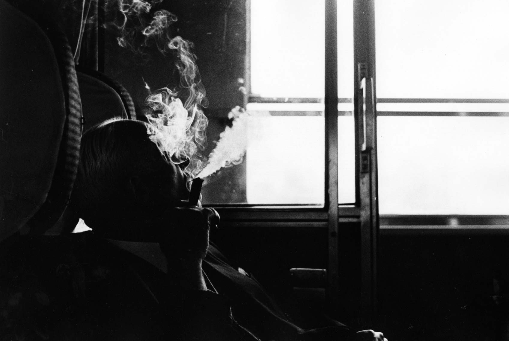 MAN WITH CIGAR ON TRAIN