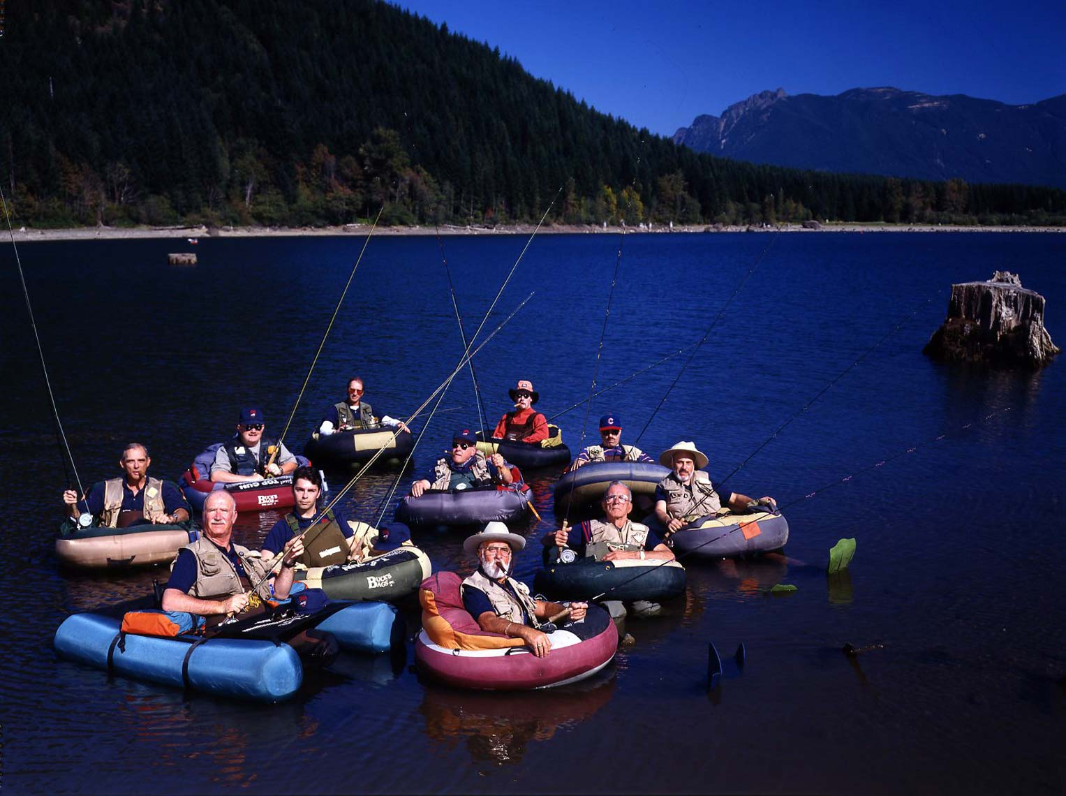 RUBBER BOAT FISHERMEN; RATTLESNAKE LAKE, WA / OUTDOOR MAGAZINE AND TV NETWORKS