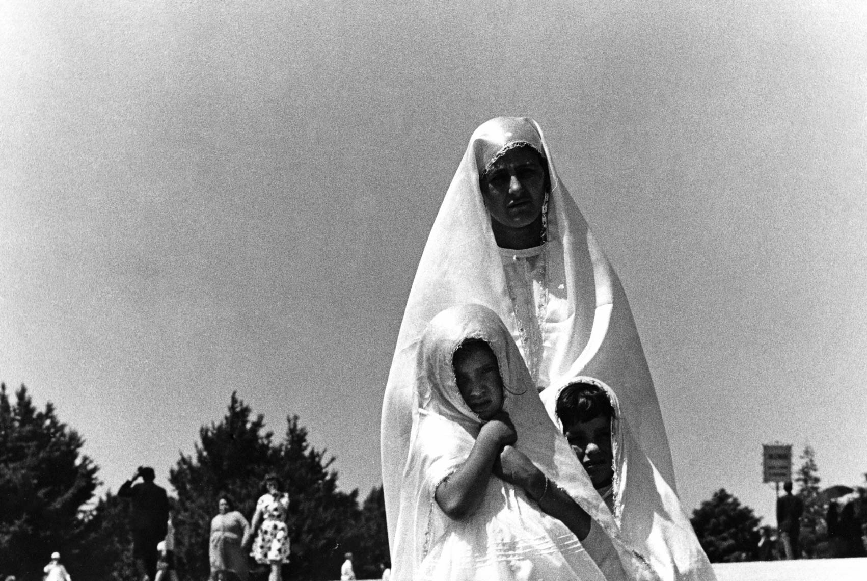WOMAN AT FATIMA WITH TWO CHILDREN