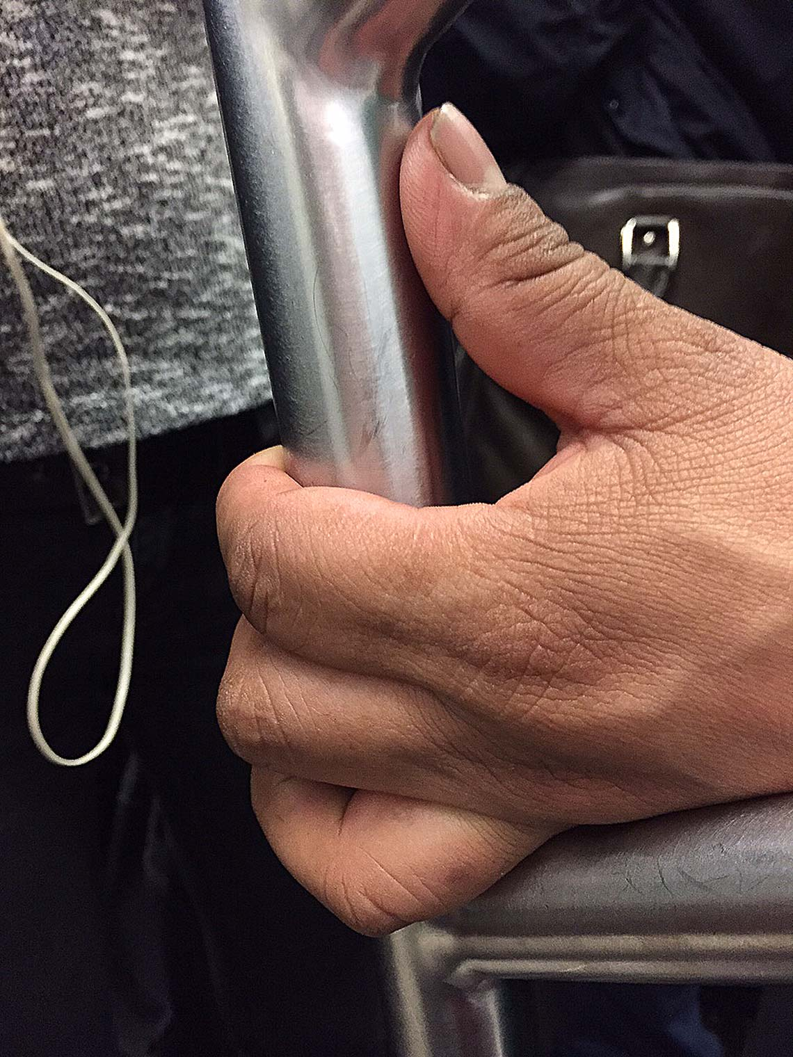 hand-on-subway-pole